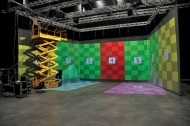 The magic box is a mobile virtual reality room that is used to project images and track the dancers' movements