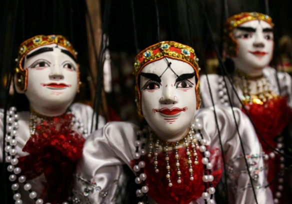 """The Burmese puppetry figures of """"nat-ga-daw,"""" or the spiritual medium, at Khin Maung Htwe's home theatre"""