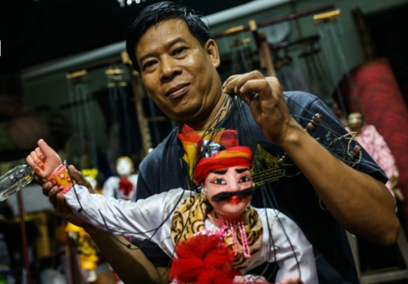 Khin Maung Htwe poses with puppet U Min Kyaw, one of the famous pantheon of 37 spirits, who is fond of drinking and merrymaking