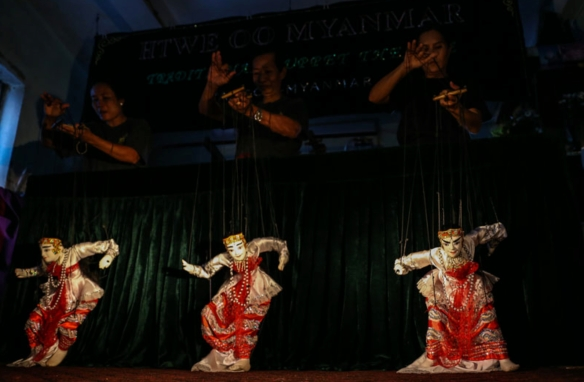 Htwe Oo Myanmar puppeteers perform a group dance of handmaiden puppets