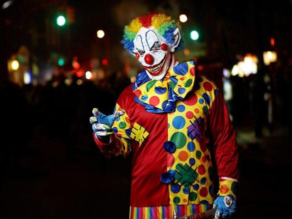 A terrifying clown walks in a Halloween parade in New York