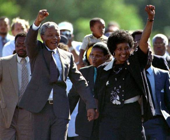 1990. Nelson Mandela as he is freed from prison after 27 years