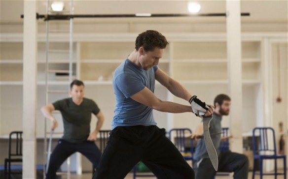 Richard Ryan, Tom Hiddleston and Hadley Fraser rehearse a fight scene for Coriolanus Photo: Rich Hardcastle